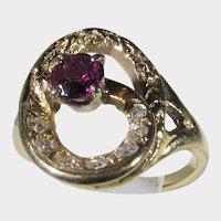 14 Karat Yellow Gold Amethyst and Diamond Swirl Ring