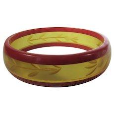 Bakelite Bangle Red and Applejuice Reverse Carved Floral Design
