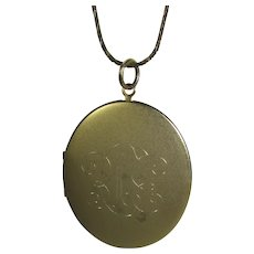 Vintage Goldtone Locket With Brushed Surface and Decorative Script