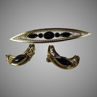Mid Century Goldtone Pin and Matching Clip On Earrings With Faux Onyx