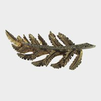 Art Goldtone Fern Pin With Crystals Down The Center