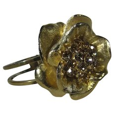 Mid Century Clamper in Floral Design In Goldtone With Aurora Borealis Crystal Center