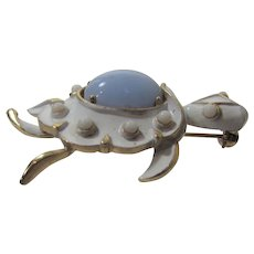 Trifari Signed Turtle Pin In White Enamel with Light Blue Glass Center