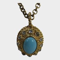 Designer Necklace With Goldtone Pendant With Faux Turquoise Center and Clear Crystal Accents