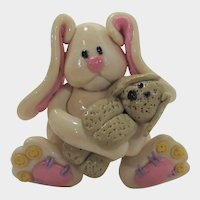 Early Hard Plastic Bunny Holding a Teddy Bear Pin in Pink and White