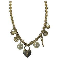 """Charm Necklace in Goldtone  With 8 Charms """"The Key to my Heart"""""""
