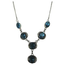 Silver Tone Sapphire Blue Crystal Necklace in Goldtone Frame
