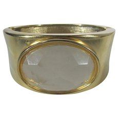 Goldtone Bangle With Clear Carved Lucite Center
