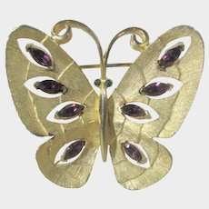 Signed J.J. Goldtone Butterfly Pin with Faux Amethyst Accents and Green Eyes