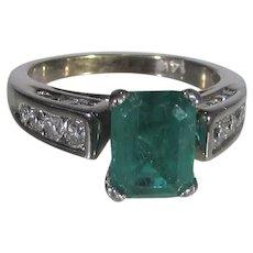 14 Karat White Gold 1.4 Ct. Natural Translucent Emerald Enhanced With Diamonds