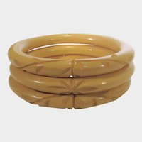 Bakelite Trio of Carved Butterscotch Bangles