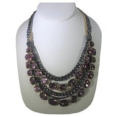 Multi Strand Necklace With Pink Crystals Alternating With Black and Goldtone Chains
