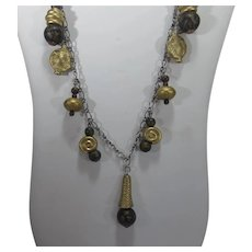 Vintage Necklace with a Variety of Goldtone and Black Pendants