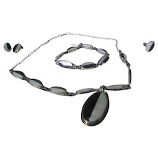 Sterling Silver 4 Piece Parure in  Onyx and Mother of Pearl Including Necklace, Bracelet, Clip on Earrings and Ring