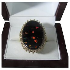14 Karat Yellow Gold  20 Carat Natural Black Opal Surrounded by Diamonds