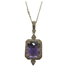 Signed Purple Crystal Pendant with Clear Crystal Surround on a Gold Tone Chain