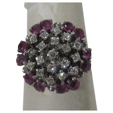 14 Karat White Gold Ruby and Diamond Cluster Ring Featuring 12 Rubies