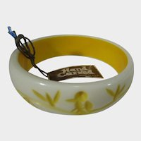 Hand Carved Mid Century Lucite Bangle In Cream Background and Yellow Bird in Tree Pattern