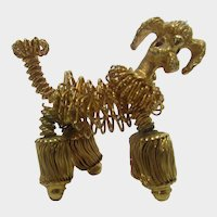Gold Tone Coiled Wire Poodle Pin with Ruby Crystal Eyes