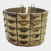 Dolce and Gabbana Couture Wide Gold Tone Stainless Steel Flex Link Cuff Bracelet