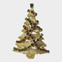 VIntage JJ Christmas Tree Pin With Red and Green Garland decorations and a Green Topper