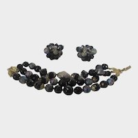 Vintage Crown Trifari Mid Century Set of Bracelet and Clip On Earrings In Black and Iridescent Beads