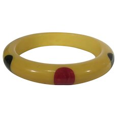 Bakelite Gumdrop Bangle in Cream Corn with Red and Dark Blue Drops