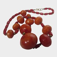 Bakelite Sunset Orange beads with Red Lucite Spacers