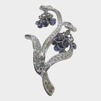 """Nolan Miller """"Dancing FLower"""" Pin in SIlver Tone With clear, Blue and Faux Smokey Topaz Crystals"""