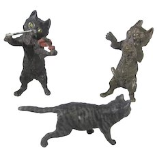 Three Bronze Cat Figurines Playing a Violin, Singing and Walking Away