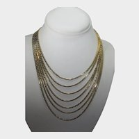 """Nolan Miller """"Star Lustre"""" Necklace With 7 Gold Tone Chains and Crystal Enhanced End Points"""