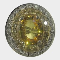14 Karat White Gold Ring With Large Natural Yellow Sapphire Surrounded by White and Yellow Diamonds