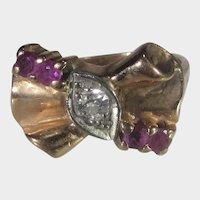 14 Karat Rose Gold Retro Ring With Center Diamond and Natural Ruby Accents