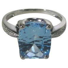 14 Karat White Gold Blue Topaz with Diamond Shoulders Ring