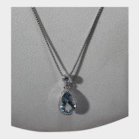 10 Karat White Gold Blue Topaz and Diamond Pendant on 14 Karat White Gold Chain