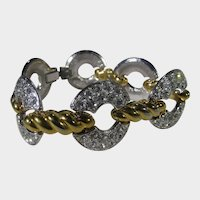 Nolan Miller Bracelet Loaded With Crystals On White and Gold Tone Finish