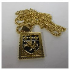 Joan River's  French Postage Stamp Pendant on KJL Gold Tone Chain