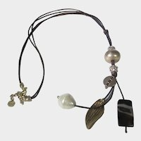 Signed Combination of Fabulous Charms On Leather Tie Necklace