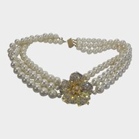 Central Flower Focal On Triple Strand of Faux Pearls