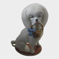 Charming Porcelain Poodle Dog Holding a Basket Circa 1920-1930