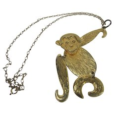 Gold Tone Jointed Monkey Pendant on a Chain