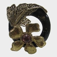 Vintage Gold Tone Flower Pin With Black Enamel and Purple Center