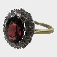 14 Karat Yellow Gold Garnet and DIamond Halo Ring