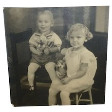 Old Photograph Of Children Toys And A Teddy Bear