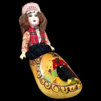 """9"""" Bisque Dutch Boy in Wooden Shoe."""