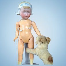 Dutch Bisque Bonnet Doll on Composition Body