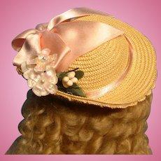 Straw bonnet with pink silk ribbon trim