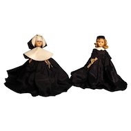 "Two 7-1/2"" 1950's hard plastic dolls---Nun and Graduate"