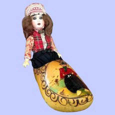 Bisque Dutch Doll Sitting in a Wooden Shoe. Cabinet Size