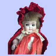 Red Riding Hood Googly.  All Bisque. Excellent Condition